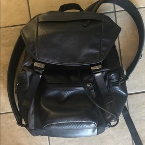 I am selling this Navy Blue men's Coach backpack.